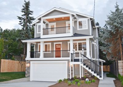 View of the exterior of an AIC Craftsman style home in the Ballard neighborhood of Seattle, Washington.