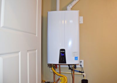 View of the modern, on-demand hot water heater.
