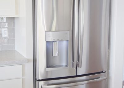 "View of a jumbo-sized stainless steel refrigerator. We find that 90% of customers prefer  the ""French Doors"", with freezer below, approach to refrigerator design."