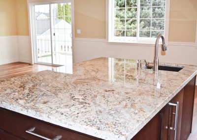 View of a spacious granite countertop island.