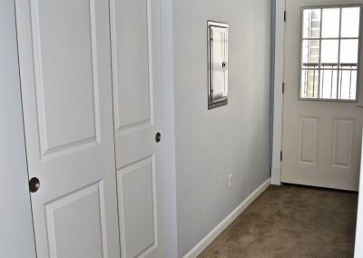 View of basement hallway and doors leading to the exterior door.
