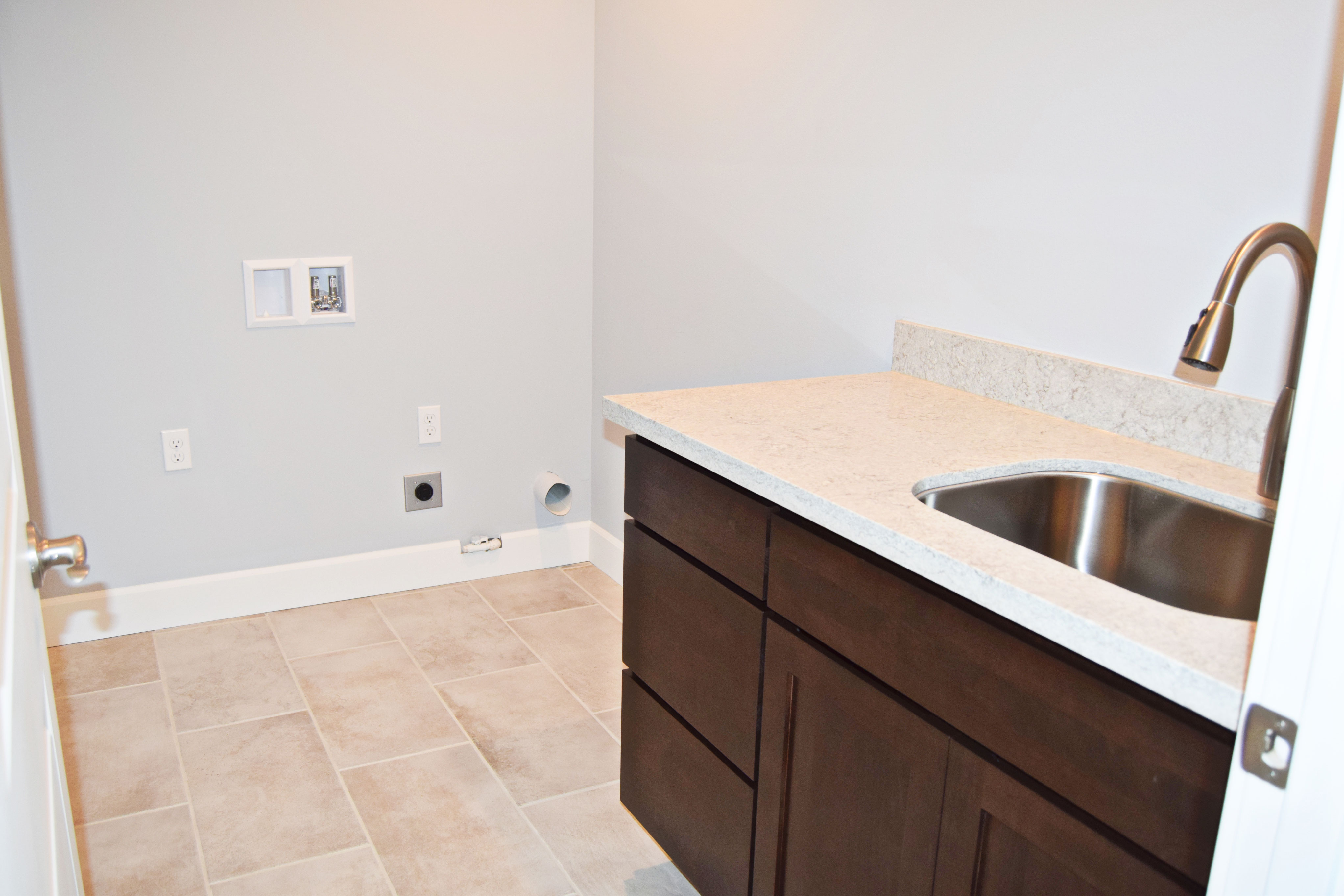 View Of The Laundry Room (sans Appliances) And Custom Built Cabinet For  Laundry Utility Sink.