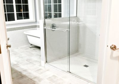 View of a master bathroom in the evening.
