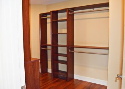 View of built in shelving in the master bedroom's walk-in closet.